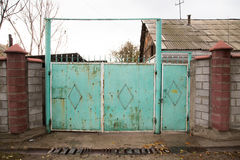 Old iron gate as a backdrop. A photo Stock Photography