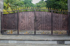 Old iron gate. An old iron gate in front of a house in Bali royalty free stock images