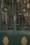 Old iron gate. Old green painted iron gate with golden ornaments Stock Photo