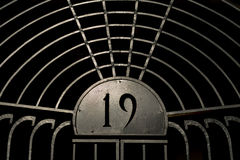 Old iron gate a with number 19 on it Stock Photo