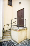 Old iron gate with railing and staircase to the church Stock Photography