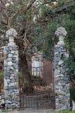 Old iron gate between two masonry. Brick pillars Royalty Free Stock Photography