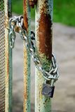Old iron gates closed wiyh chain and  padlock Royalty Free Stock Image
