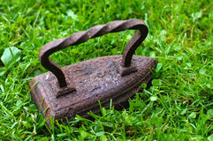 Old iron on green grass. Royalty Free Stock Images
