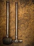 Old iron hammer and rubber hammer hanging Royalty Free Stock Image