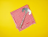 Old iron hatchet for cutting meat or vegetables on yellow background. Top view stock images