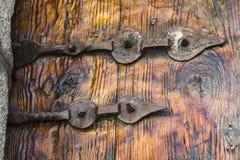 Old iron hinge. Iron hinge old wooden door Stock Photography