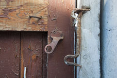 Old iron hook closed door Stock Image