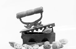 Old iron and jar on white background. Old iron isolated on white background Royalty Free Stock Images