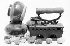 Old iron and jar on white background. Old iron isolated on white background Royalty Free Stock Photos
