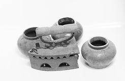 Old iron and jar on white background. Old iron isolated on white background Royalty Free Stock Photography