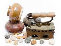 Old iron and jar on white background. Old iron isolated on white background Royalty Free Stock Photo