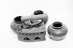 Old iron and jar on white background. Old iron isolated on white background Royalty Free Stock Image
