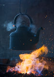 Old iron kettle on the fire, sparks fire Royalty Free Stock Image