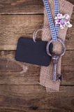 Old iron key. With a blackboard is hanging on a wooden wall Stock Photo