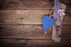 Old iron key with a heart Stock Image