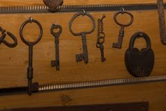 Old iron keys and a lock Royalty Free Stock Photos