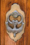 Old iron knocker on an old metal door in the Spain Stock Photo