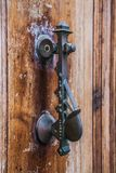 Old iron knoker on an old metal door Royalty Free Stock Photography
