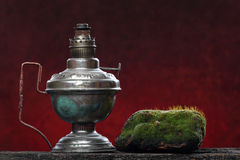 Old iron lamp still life. Ecologic concept Royalty Free Stock Images