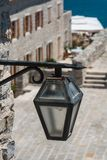 Old iron lantern in the street stock photography