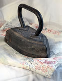 The old iron on light fabric Royalty Free Stock Photo