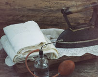 Old iron, linen and sprinkler Royalty Free Stock Photography