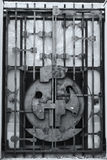 Old iron locked gate door. Old iron locked gate bank vault door Royalty Free Stock Image