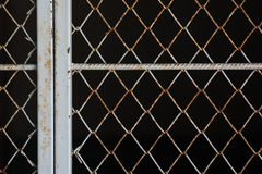 old iron net with black background Royalty Free Stock Photography