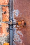 Old iron oven door with a rusty bolt. stock photo