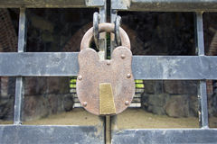 Old Iron Padlock on Gate Stock Photography