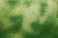 Old iron plate painted with green spots Royalty Free Stock Photo