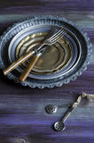 Old iron plates and cutlery Stock Photo