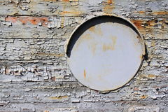 Old iron porthole on wooden Royalty Free Stock Images