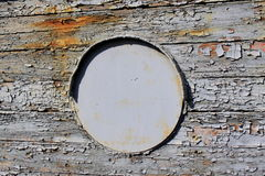 Old iron porthole on wooden Stock Photo