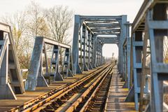Old iron railroad bridge in remote rural area in Europe Stock Photography