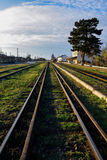 Old iron rails with green grass Stock Photo