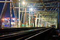 Old iron railway bridge. Old iron railway bridge for the passage of trains, at night Royalty Free Stock Photos