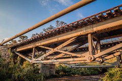 Old iron railway bridge in a rural area in the afternoon Royalty Free Stock Photo