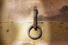 Old iron ring fixed to a stone wall Royalty Free Stock Image