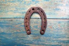 Old iron rusty metal horseshoe on weathered wood Royalty Free Stock Photos