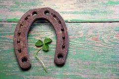Old iron rusty metal horseshoe on weathered wood Stock Photography