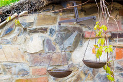 The old iron scales on a stone wall Royalty Free Stock Photos