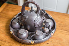 Old iron set for calvados. Closeup old iron set for calvados on wooden table Royalty Free Stock Photography
