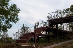 Old iron stairs that are going to rust in the woods. royalty free stock photography
