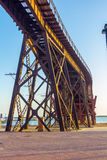 Old iron structure to transport minerals to praise boats almeria Royalty Free Stock Images