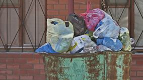 Old iron trash can clogged full full. tank trash garbage a lot of pollution. Old iron trash can clogged full full. tank trash garbage lot of pollution stock video footage