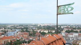 Old iron vane standing on the building roof, view on amazing Gdansk city, Poland. Stock footage stock footage