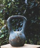 Old iron vintage sports weight with a handle stock photos
