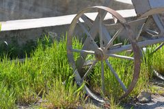 Old iron wheel from a vehicle in the yard Stock Image